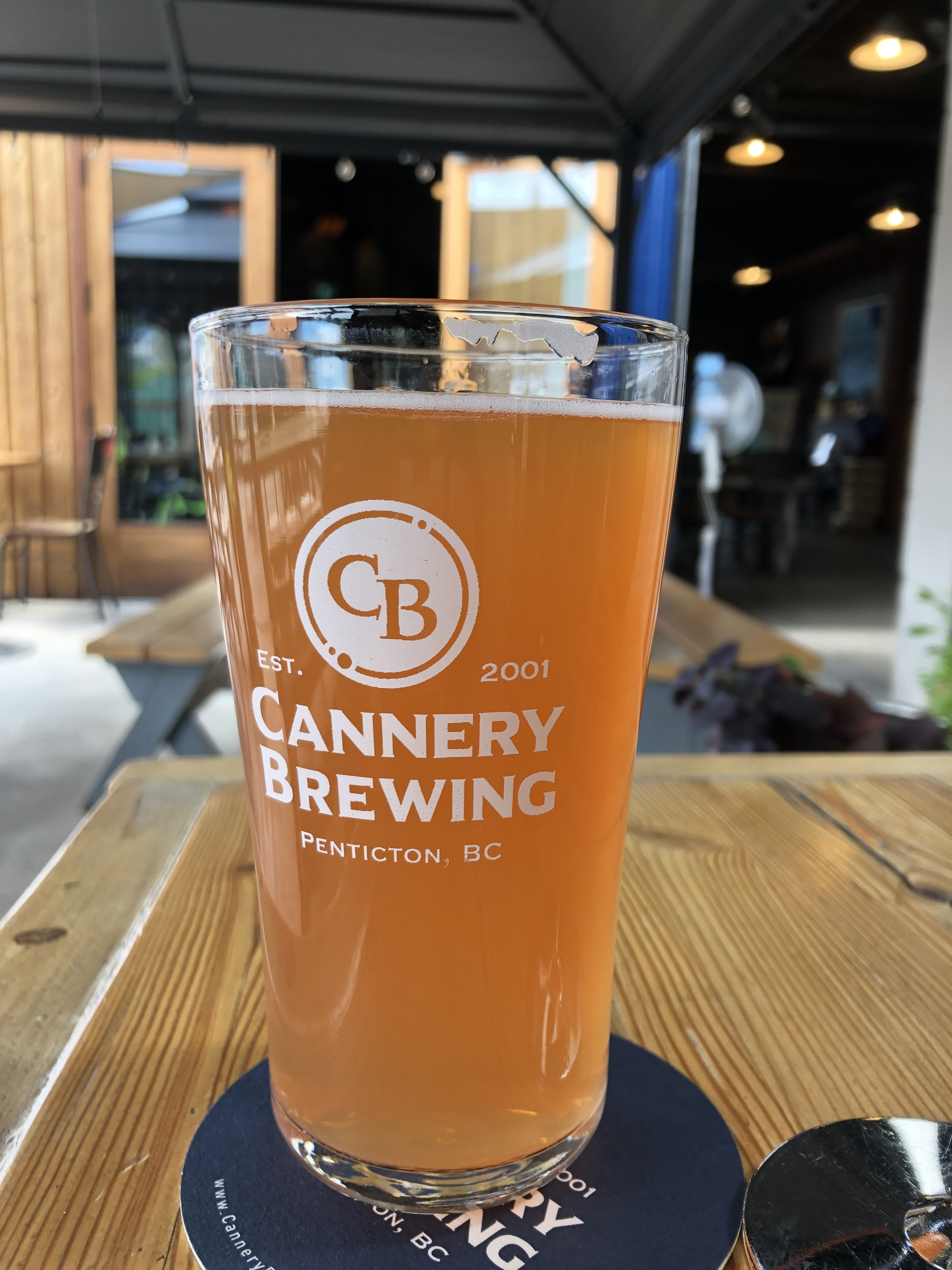 Picture of a pint glass with Cannery Brewing logo.